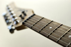 Electric guitar fingerboard. Photo of guitar fingerboard isolated royalty free stock images