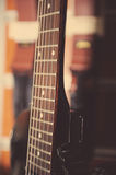 Electric guitar fingerboard. Against colorful background Stock Image