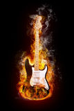 Electric guitar. In flames on black background Royalty Free Stock Photo
