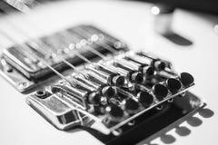 Electric guitar floyd rose bridge. A close-up angled image of an electric guitars bridge area Stock Photography