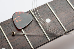 Electric guitar frets with string and yellow nippers. Guitar frets with string and mediator Stock Images