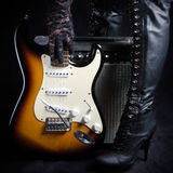 Electric Guitar In Front of Amplifier Picked Up by a Goth Woman stock images