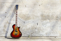 Electric guitar in front of a vintage wall Royalty Free Stock Photography