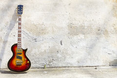 Electric guitar in front of a vintage wall Stock Photo