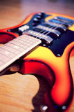Electric guitar on a grungy old wooden surface Royalty Free Stock Photography