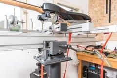 Electric guitar in handmade domestic music instrument service repair made in garage stock image