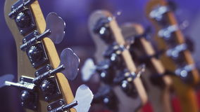 Electric guitar head. String instruments. Music guitar headstock. Electric guitar head selective focus. Close up of electric guitar headstock. Electric guitar stock video