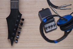 Electric guitar, headphones and distortion unit Stock Photography