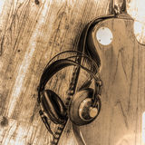 Electric guitar and headphones in sepia tone Royalty Free Stock Photography