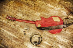 Electric guitar and headphones in vintage tone Royalty Free Stock Images
