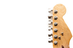 Electric guitar headstock detail isolated. Electric guitar wooden color headstock and tuning peg detail isolated on white Royalty Free Stock Photography
