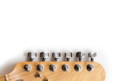 Electric guitar headstock detail. Electric guitar wooden color headstock in horizontal position detail on white background Stock Images