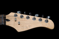 Electric guitar headstock isolated on black Royalty Free Stock Photography