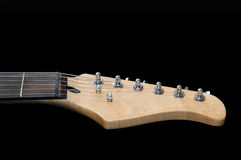 Electric guitar headstock isolated on black Royalty Free Stock Photos