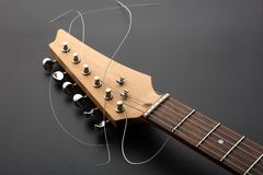Electric guitar. Headstock and tuning machines. Macro view Royalty Free Stock Photo