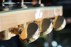 Electric guitar headstock tuning pegs detail, music symbol Royalty Free Stock Images