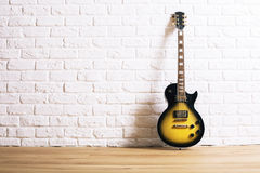 Electric guitar in interior Royalty Free Stock Photography
