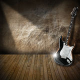 Electric Guitar in Interior Grunge Room. Black and white electric guitar in a old abandoned interior vector illustration