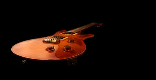Electric guitar isolated. On black background stock photography