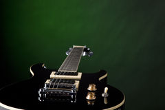 Electric Guitar Isolated on Green Royalty Free Stock Photography