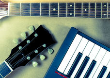 Electric guitar and keyboard neck  musical close-up  isoled Stock Image