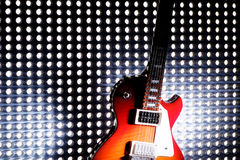 Electric Guitar On Lighting Grid Stock Images