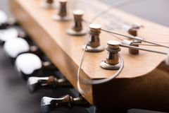 Electric guitar. Macro of electric guitar headstock Royalty Free Stock Images