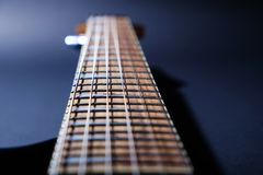 Electric guitar macro shot of a fretboard.Soft selective focus. On black. Background stock photography