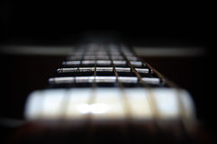 Electric Guitar. Macro shot of an electric guitar in low light Royalty Free Stock Photo
