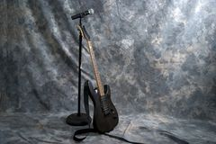 Electric guitar and microphone Stock Images