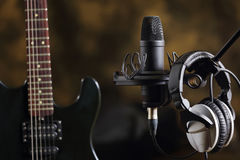 Electric guitar, microphone and earphones Royalty Free Stock Image