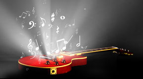Electric guitar with music. Notes flowing stock images