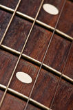 Electric guitar neck. Close up on a guitar neck with strings stock photo