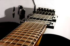 Electric Guitar Neck and Body. With white light and strings Stock Photography