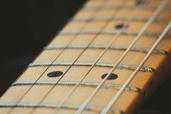 Electric guitar neck detail, music symbol Stock Photos