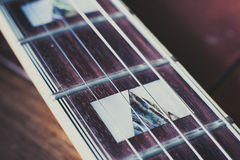 Electric guitar neck detail, music symbol Royalty Free Stock Image
