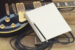 Electric guitar with notepad Royalty Free Stock Image
