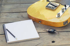 Electric guitar with notepad Royalty Free Stock Images
