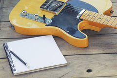 Electric guitar with notepad Stock Photography