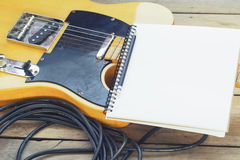 Electric guitar with notepad Royalty Free Stock Photography