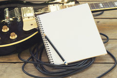 Electric guitar with notepad Stock Images