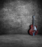 Electric guitar. In an old abandoned interior royalty free stock image