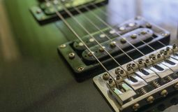 Electric guitar part close-up. Neck and humbucker pickup. Horizontal composition. Studio shot. stock photo