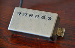 Electric Guitar Pickup - Humbucker - Aged and Vintage Royalty Free Stock Photo