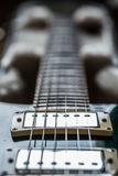 Electric guitar pickups and neck close up view Stock Photography