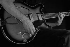 Electric Guitar Player. Close up of electric Guitar player in B&W, shallow DOF, some motion blur Stock Photos