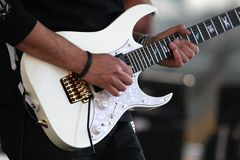 Electric guitar and player. During the gig Royalty Free Stock Image