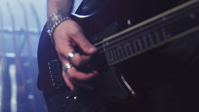 Electric guitar player hand. Rock guitar tuning. Man playing electric guitar. Man hand playing electric guitar. Electric guitar player hand . Close up of man stock footage
