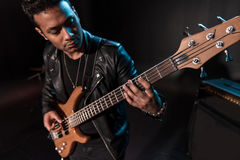 Electric guitar player performing hard rock music with bass guitar. On stage stock images