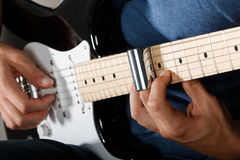 Electric guitar player performing song Royalty Free Stock Image